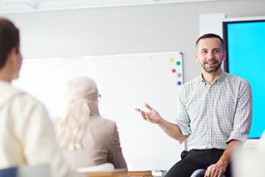 man teaching class